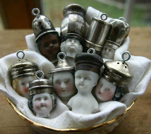 Hmmm...do I really want to start de-capitating porcelain figurines?  Very cute...a little scary, though.