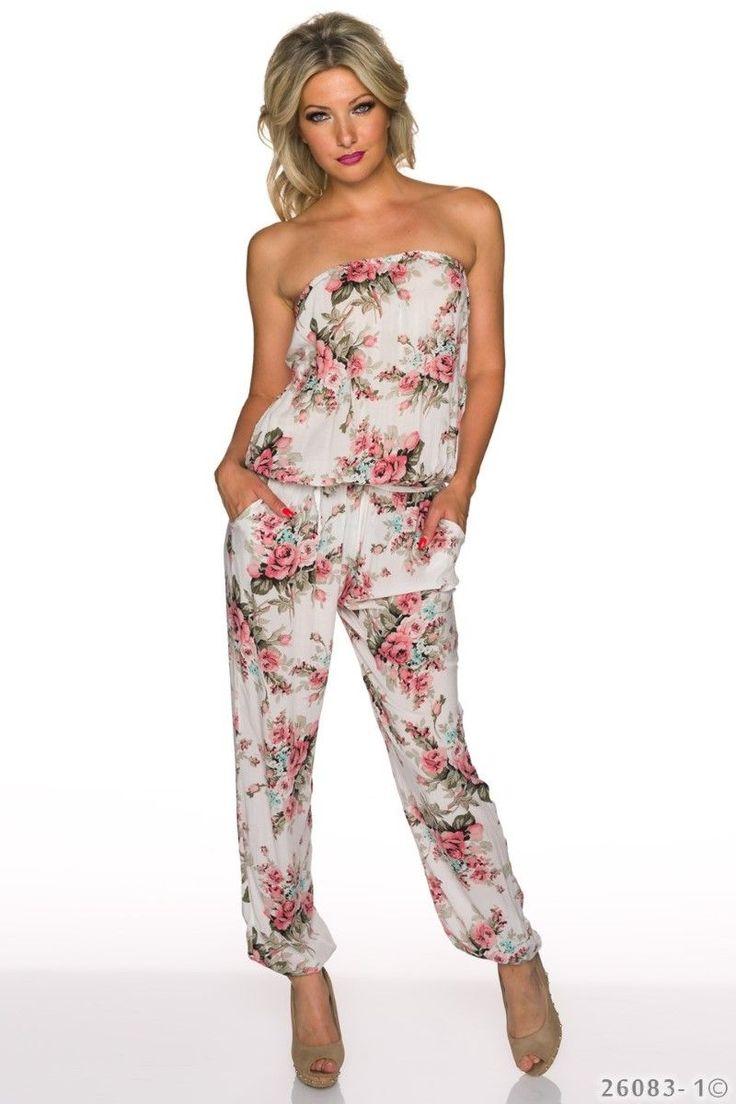Στράπλες φλοράλ ολόσωμη φόρμα με τσέπες.Ύψος μοντέλου: 1,72m100% Viscose