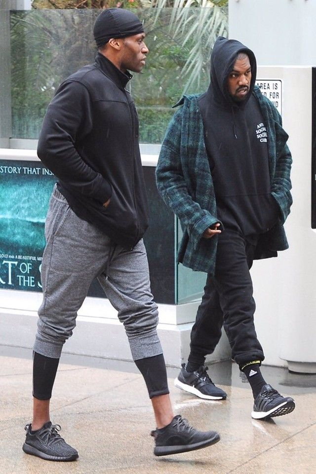 Kanye West wearing  Faith Connexion Oversized Shirt, Adidas Ultra Boost Shoes, Adidas Traxion Premier Crew Socks Large 1 Pair, Anti Social Social Club Mind Games Hoodie