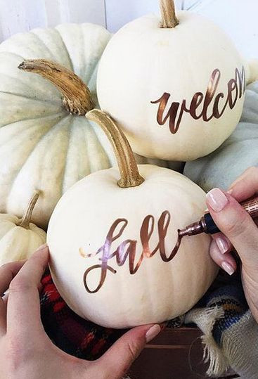Pumpkin metallic and cream DIY wedding decoration signs.