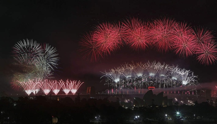 Fireworks explode in the sky above Sydney Harbour