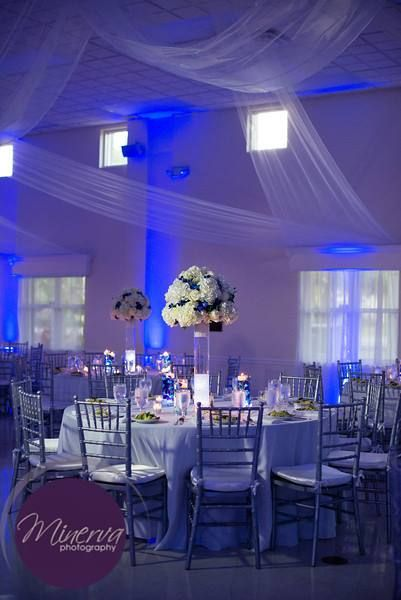 Gorgeous Centerpieces And Setup At This Blue Uplighting Wedding Reception In
