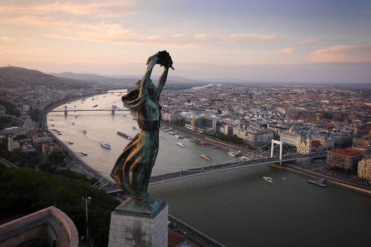 The windswept Liberty Statue, overlooking Budapest by Amos Chapple