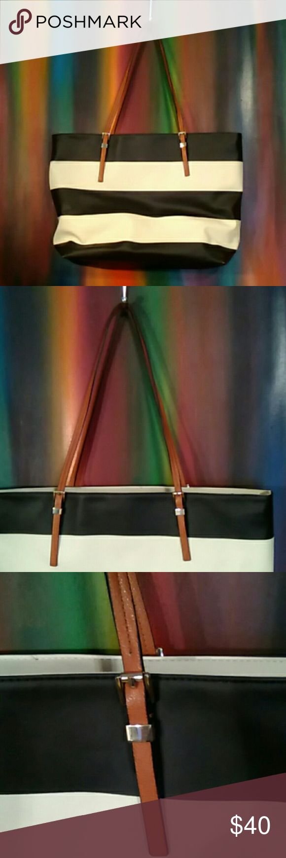 Banana Republic Vegan Leather Tote N w o t-Banana Republic vegan leather black and white striped tote bag with light brown straps. Gold Hardware. Zip top closure. Large pocket inside with zip closure on back panel. 19 x 14, strap drop is 12 in. Some fading on bottom corners( photo 4) overall great condition. Hot pink interior, Made in China Banana Republic Bags Totes