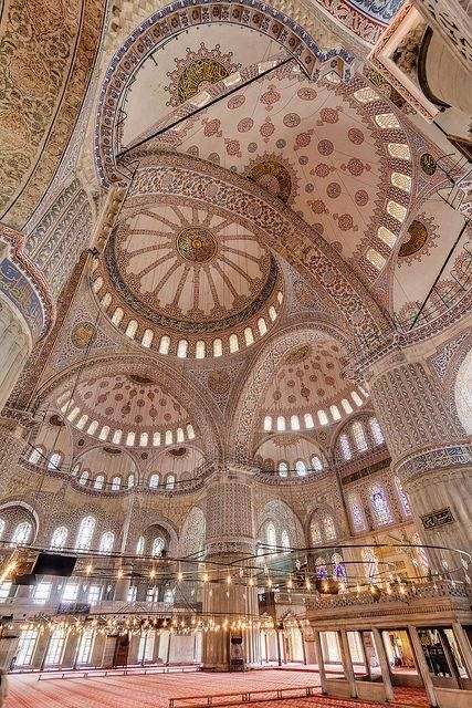 "The cascading domes and six slender minarets of the Sultanahmet Mosque (better known as the ""Blue Mosque"") dominate the skyline of Istanbul. Blue Mosque Hall- view of beautiful interior of the magical cascading domes 