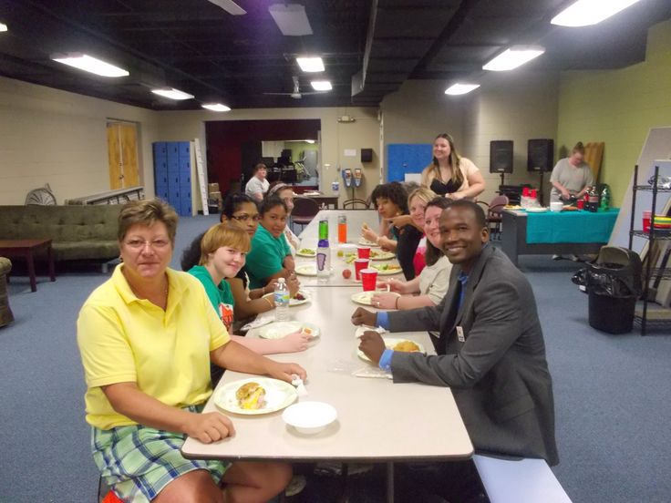It's a fun, rainy Tuesday at YWCA! Enjoying each other's company with a staff pot luck!