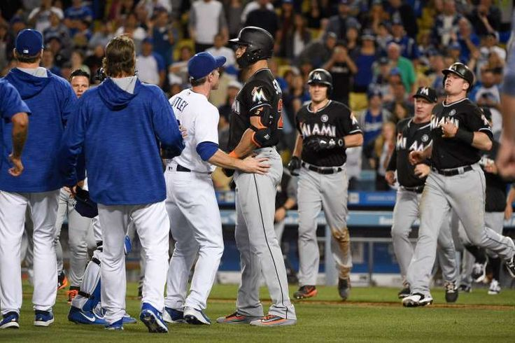 May 19: Umpire Carlos Torres ejects Dodgers pitcher Ross Stripling (not pictured) for throwing at Marlins batter Giancarlo Stanton.