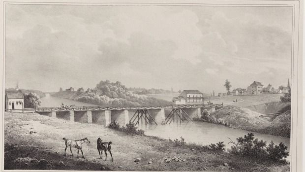 Lithograph of the Gaol Bridge in Parramatta in 1826. The horses are standing behind where the Riverside Theatre now is.The bridge was built on stone piers with timber railings. Photo: State Library of NSW.  from SMH