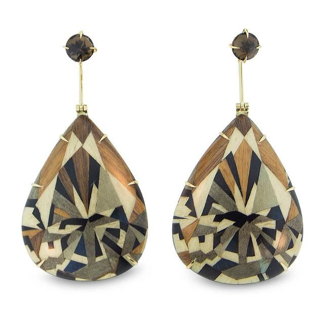 These earrings feature a stunning pattern of inlaid woods in the shape of a sensuous pear. Set in 18-karat yellow gold and topped with a smoky quartz, they are an elegant and modern statement.