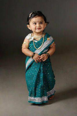 cute ethnic lover baby in a saree