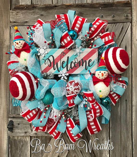 Snowman Christmas Wreath, Christmas Decor, Winter Wreath, Holiday Wreath, Rustic Christmas Snowman Welcome❤️☃️❤️ Invite this Christmas season with a Rustic Whimsical Snowman Wreath! Frosty is so cute & charming and the colors are filled with shimmering FUN in red, turquoise and white! The centerpiece is a wooden sign created by The Rusted Chick. The sign features fun stripes which coordinates wonderfully with the whimsical snowmen. Ribbons in red & turquoise weave throughout, an asso...