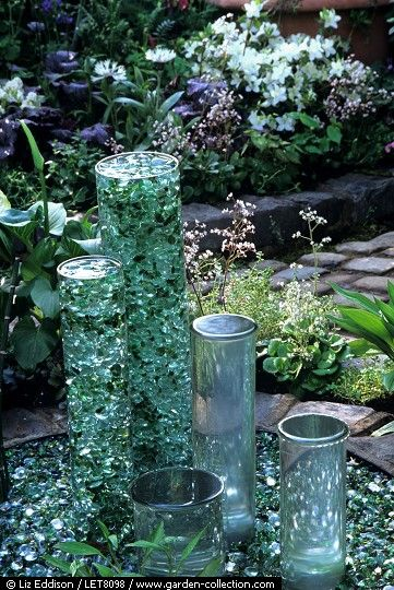 Glass or plastic tubes filled with glass stones, marbles or other shiny objects then filled with water.