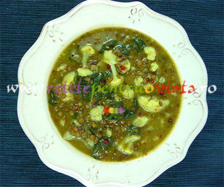 Reteta de supa de linte cu conopida, spanac si curry este o varianta a retetei clasice de supa de linte, imbogatita cu legume.