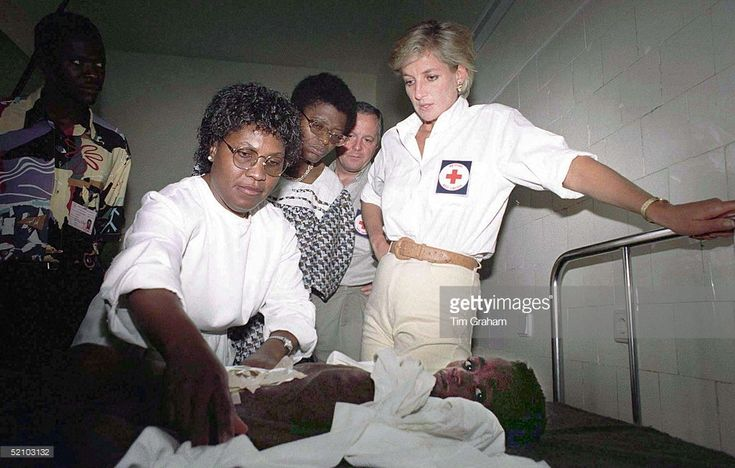 January 15, 1997: Diana, Princess Of Wales watches seven-year old Helena Ussoua who lost most of her intestines In a landmine blast being cared for by a hospital worker at an Orthopaedic Hospital, Huambo, Angola.
