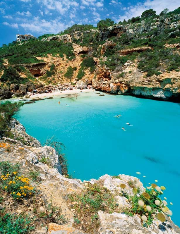 Cala S'Almunia, Mallorca. Spain  I've been there and I love it! clear blue water, colourful fish and big cliffs :)