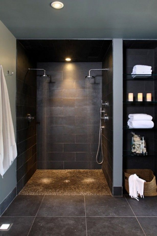 cool idea- river rock on the floor. big squares on the floor and rectangular in the shower... but all same color. I like that.