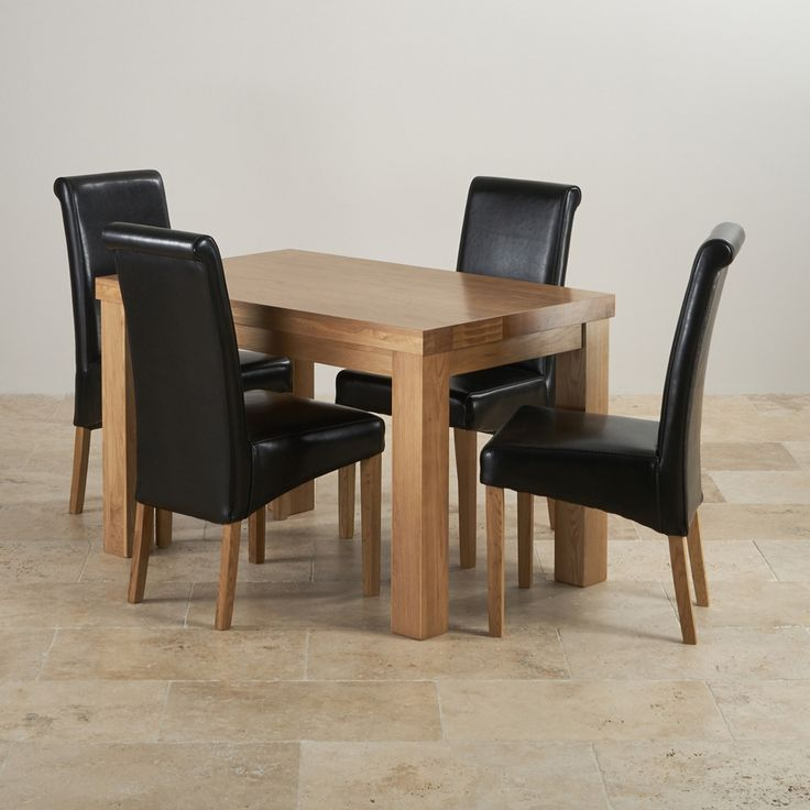 this modern dining set combines a stunning 4ft chunky dining table with 4 black scroll back