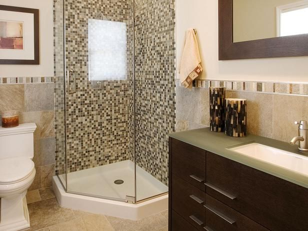 This corner shower uses a standard pan base and simple glass walls and door.  This can minimize some cost, encourage light penetration, and still provide the opportunity for brilliant tile accents.