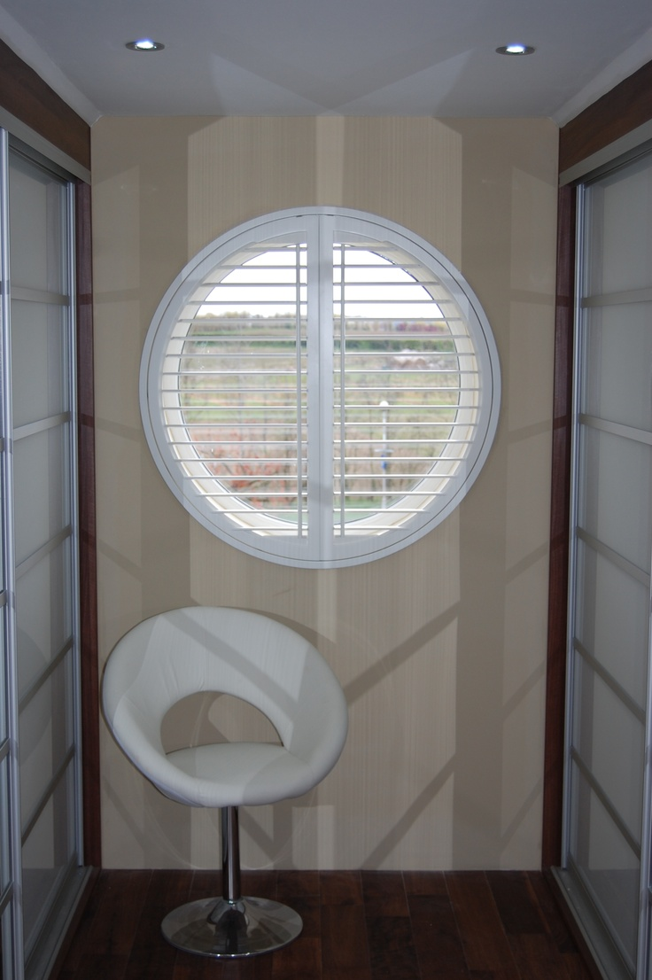 Triangle windows photos supplying wooden window shutters for - Circular Window Covered Perfectly
