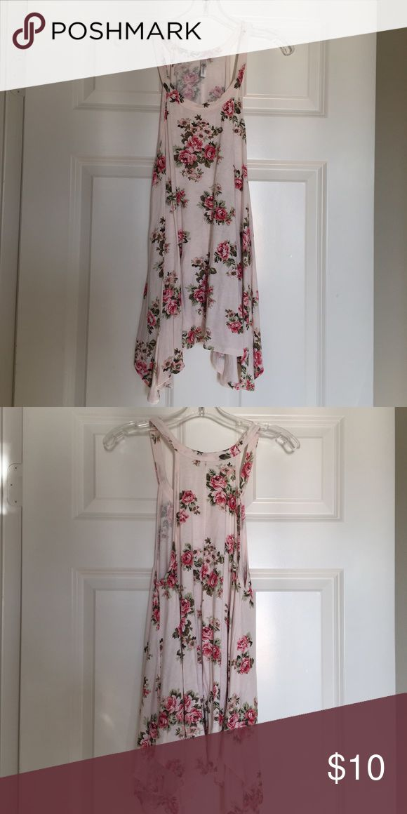 Floral tank top from The Daisey Shop Razor back floral tank! It is flowy and longer on the sides. Light pink. Very soft material Daises Tops Tank Tops