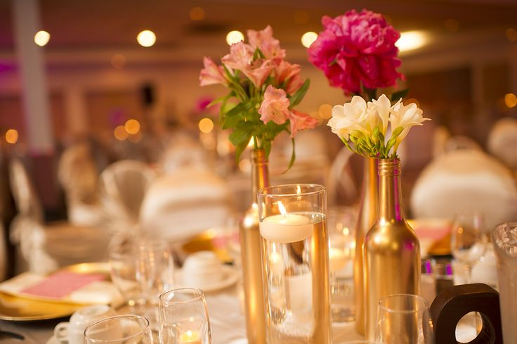 Gold painted bottles make perfect vases for a centerpiece for Painted wine bottle wedding centerpieces