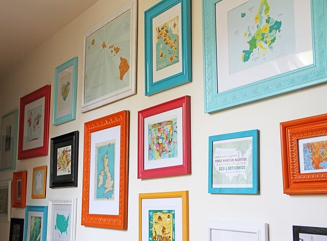 Map wall with spray painted frames. Cute!