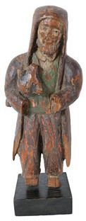 Antique hand-carved Santos figure of Saint Francis, Patron Saint of the Animals. He his holding an animal in his arms. This figure was made in the 17th to 18th century and has much of its original paint. The base is a later addition for display. No maker's mark. Losses and wear. wood Brand: Retailer: One-Kings-Lane-Vintage