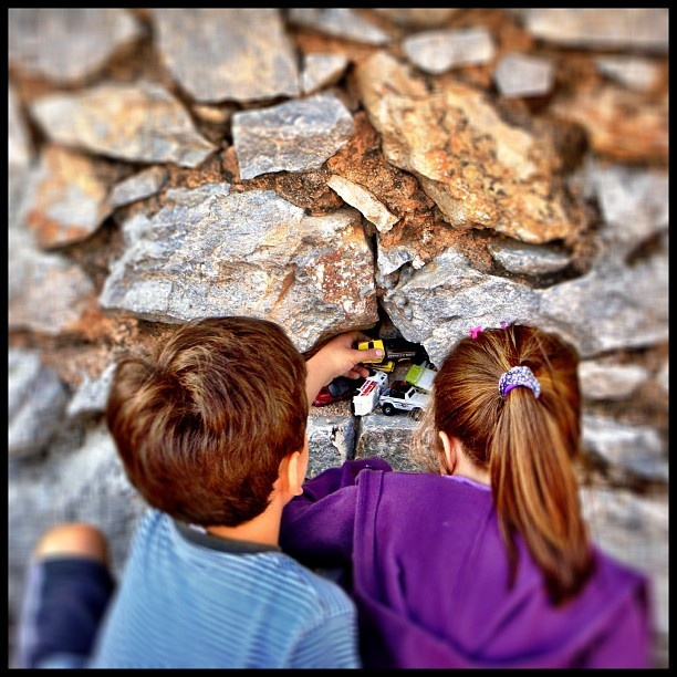 Boy and girl hiding toy cars - Let the children play!