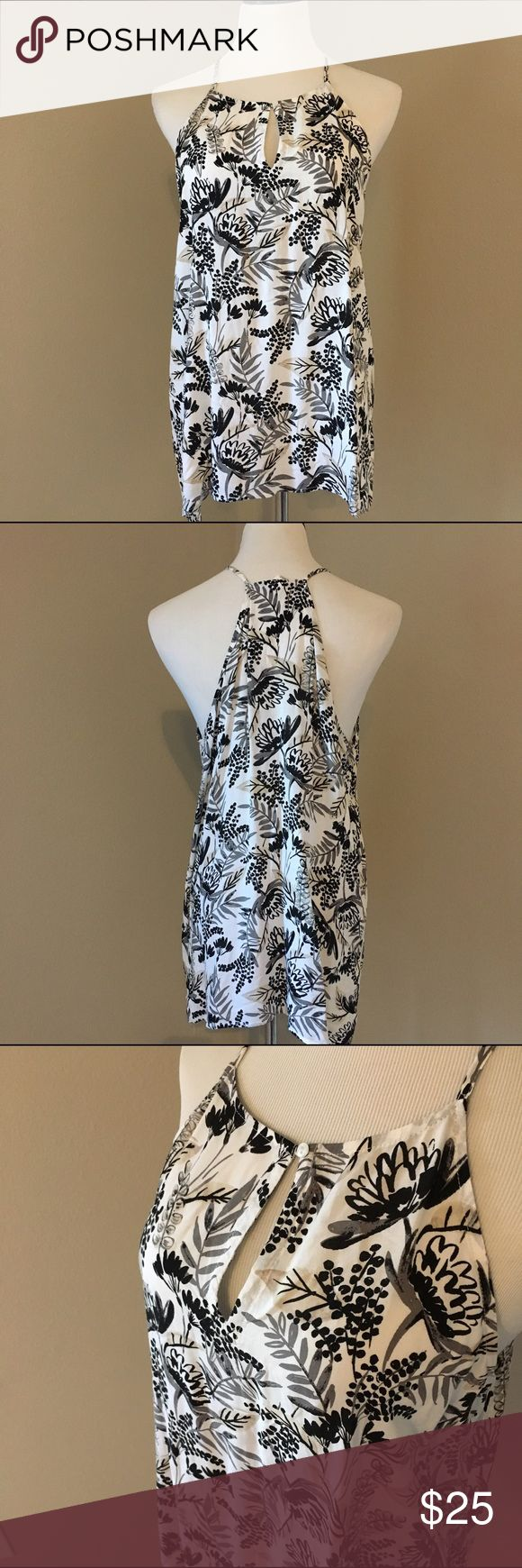 Racerback Tank Top Tropical/Floral print and lightweight material. In excellent used condition. Measurements only by request. Old Navy Tops Tank Tops