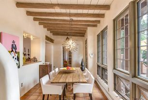 Southwestern Dining Room with flush light, terracotta tile floors, High ceiling, Exposed beam, Pendant Light