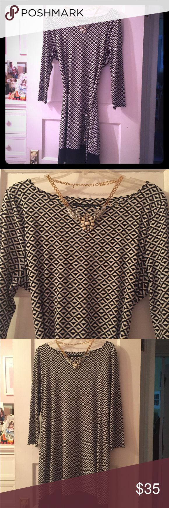 Ivanka Trump Geometric Print Dress Beautiful draped dress with eye catching black and white diamond geometric print, contrast black band at the hem of the dress and a thin fabric tie belt to adjust the waist of the dress. Long sleeve, slight boat neck styling and simple scoop. Excellent condition; worn twice but like new. Stretch material for a flattering fit. Size large would translate well to 12-14. Ivanka Trump Dresses