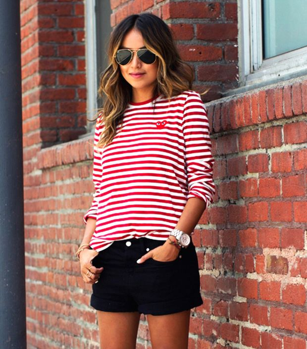 Sincerely Jules in a red and white striped Play Comme Des Garcons shirt.