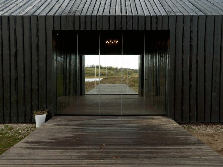 Nice use of black cladding, to roof too!