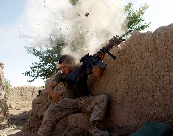 A U.S. Marine, from the 24th Marine Expeditionary Unit, has a close call after Taliban fighters opened fire near Garmser in Helmand Province of Afghanistan May 18, 2008. The Marine was not injured.