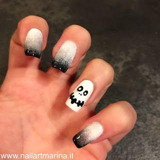 idea unghie per halloween, bianca e nera con il teschio