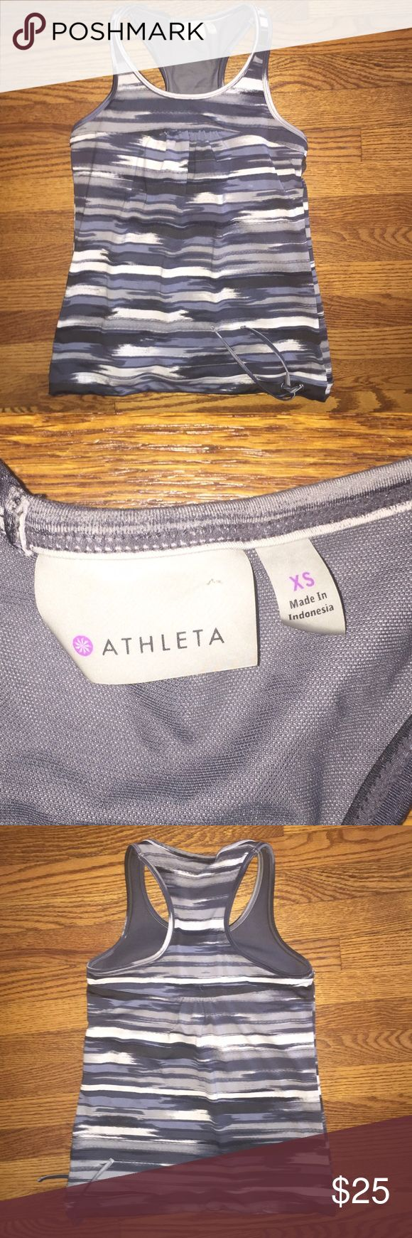 Athleta tank top...Size XS Athleta tank top with built in bra...greys and white...Size XS...no rips, stains or snags...from a smoke free home! Athleta Tops Tank Tops