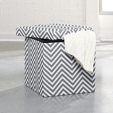 Holds books, magazines, etc. - and in a cute chevron finish!
