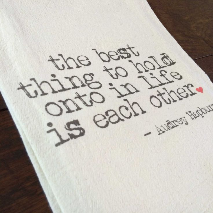 """The best thing to hold onto in life is each other"" printed onto a lint-free, natural, unbleached 100% cotton flour sack towel. Handmade in Georgia, United States"
