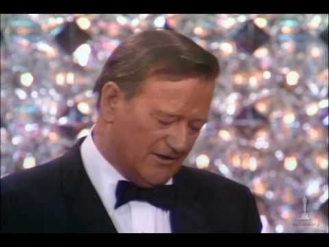 "John Wayne winning the Best Actor Oscar® for his performance in ""True Grit"" - 42nd Annual Academy Awards® in 1970. Presented by Barbra Streisand."