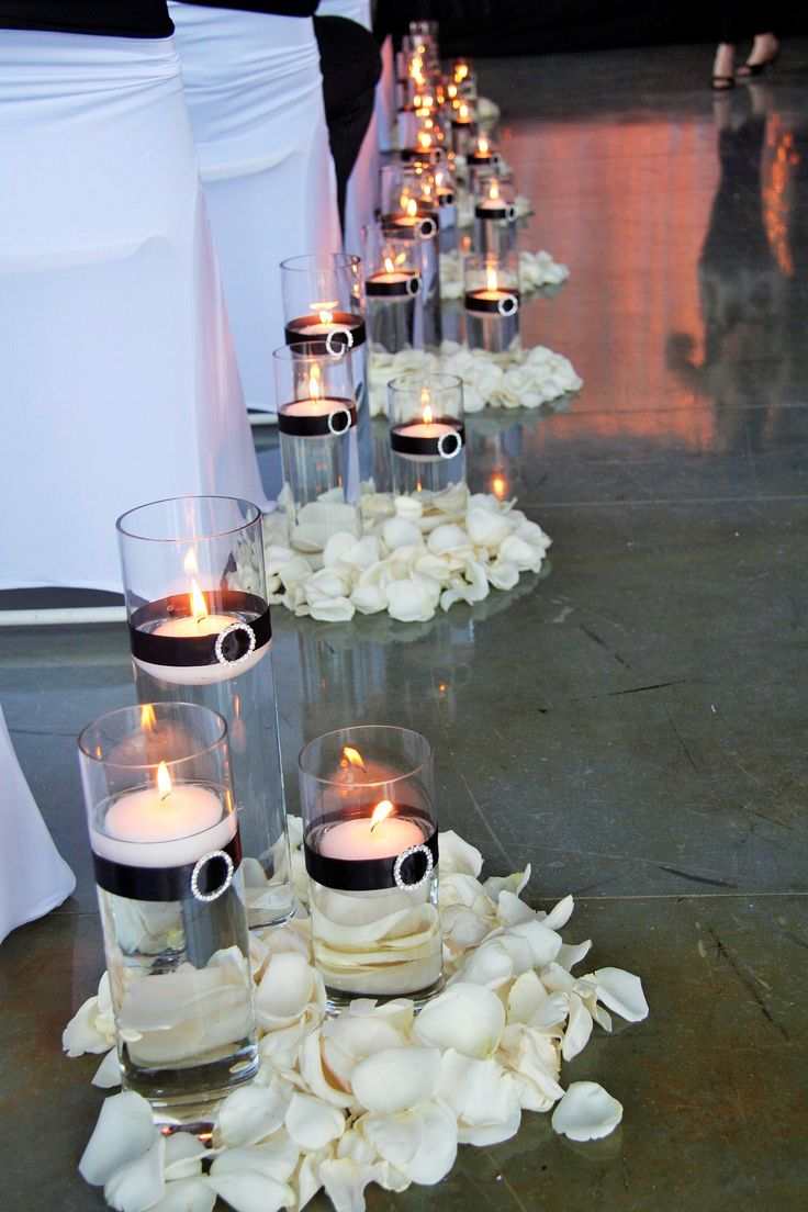 church wedding decorations candles%0A Wedding Decor   Glass Cylinders with Floating Candles and Black Ribbon  surrounded by White Rose