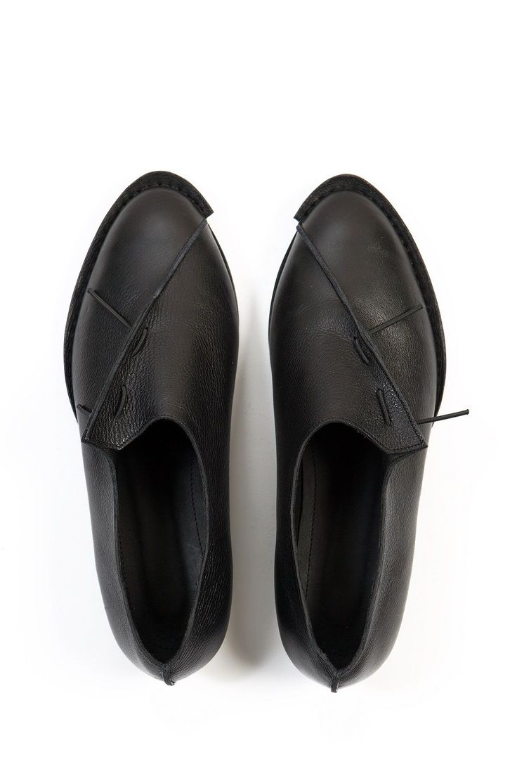 more fabulous black slip on shoes does anyone know who designed them?
