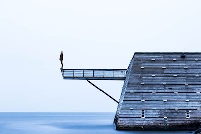 Johan Bengtsson - Titanic. A photo of a man standing on a wooden pier.