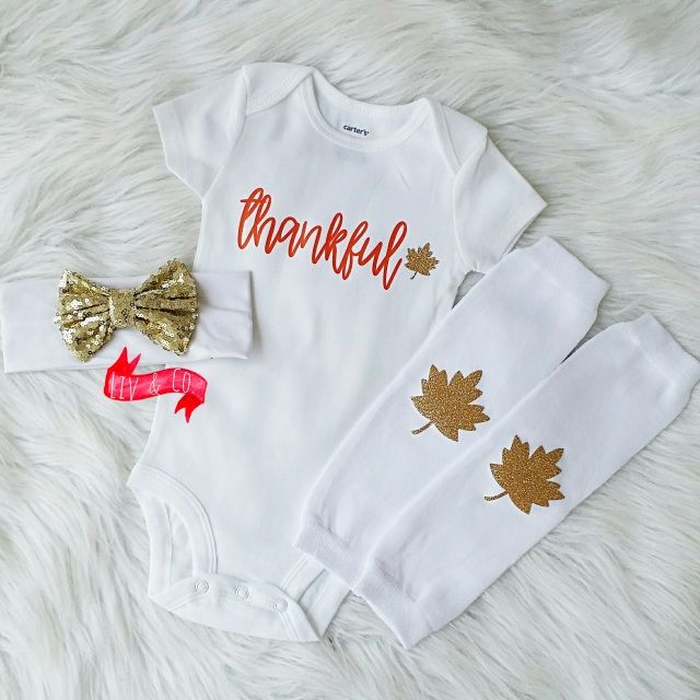 """Ring in Fall and the season of togetherness with our """"Thankful"""" outfit set. Complete with a baby bodysuit or children's t shirt featuring """"thankful"""" in a beautiful cursive font and glitter gold leaf with coordinating leg warmers and a white headband with a gold sequin bow."""