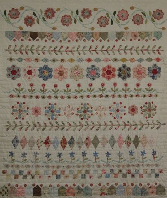Small applique quilt done in the band style of the 17th century. Much of the work is done over English paper pieces. Pattern is available for sale
