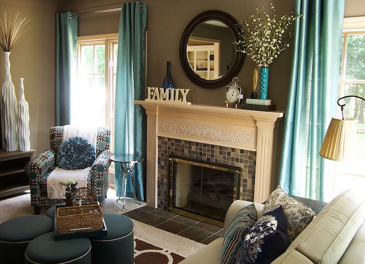 Captivating An Inviting Taupe And Turquoise Living Room Featuring Fun Patterns And  Textureswith Fireplace By Lindsay Hoekstra