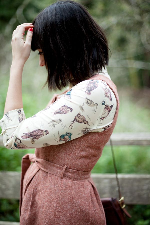 Great way to layer a sleeve-less dress - I almost always layer a cute blouse underneath.
