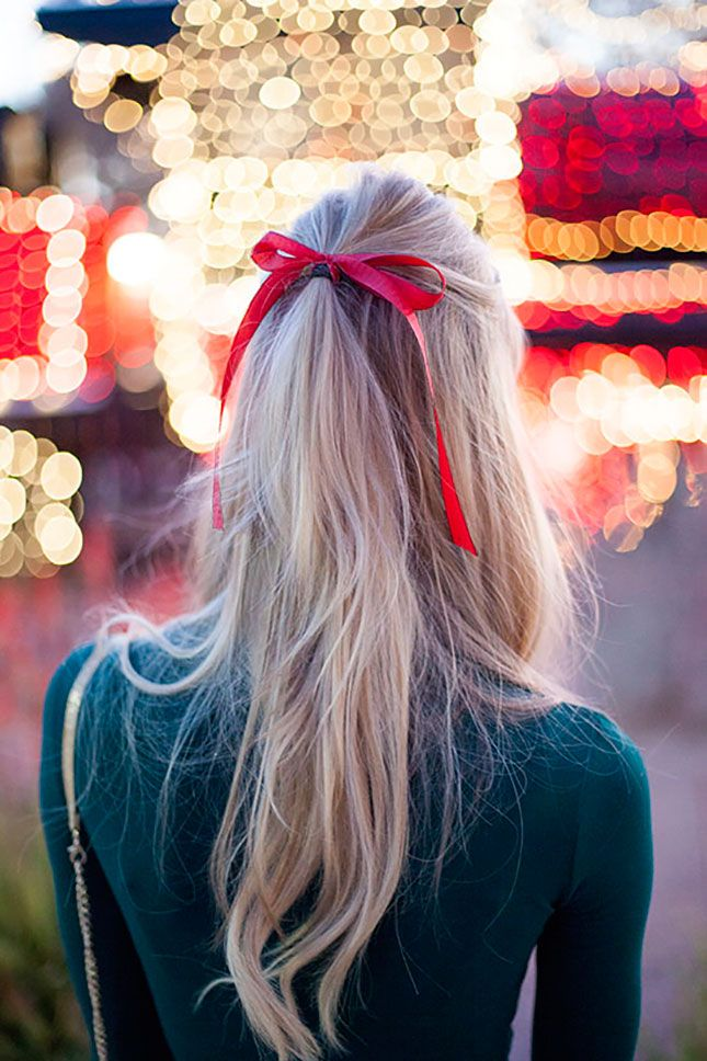Glam up your holiday hair with a little red ribbon.: