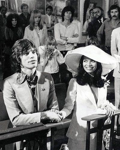 Mick & Bianca Jagger. St. Tropez. Marriage. S) | wedding | rock n roll | rock stars | holding hands | love | passion | glamorous | kneeling | church | I do |: