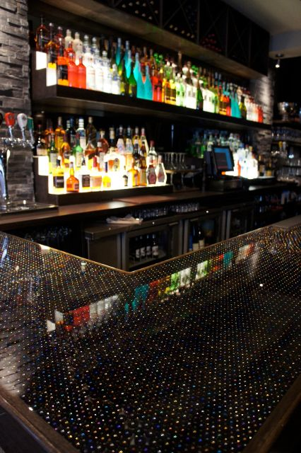 Commercial Bar Design Ideas chevron backsplash subway tile commercial design bar ideas stool seating restaurant Hushs Bar Top Made Up Of 24000 Marbles