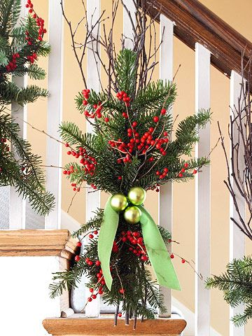 Dress up a banister by tying garland, berries, and twigs to it.